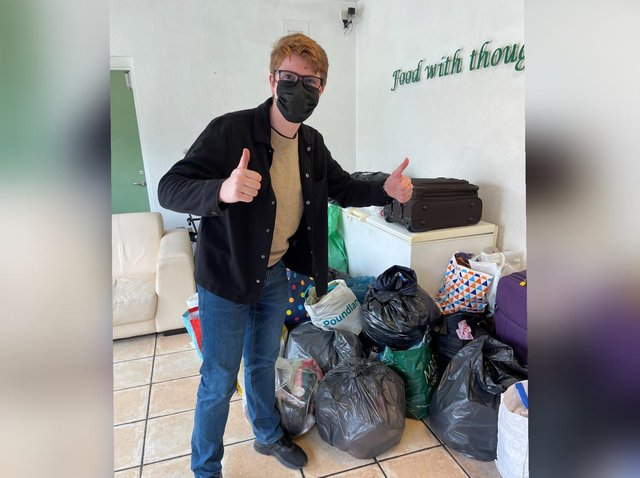 Cllr Seth Goddard with some of the donations